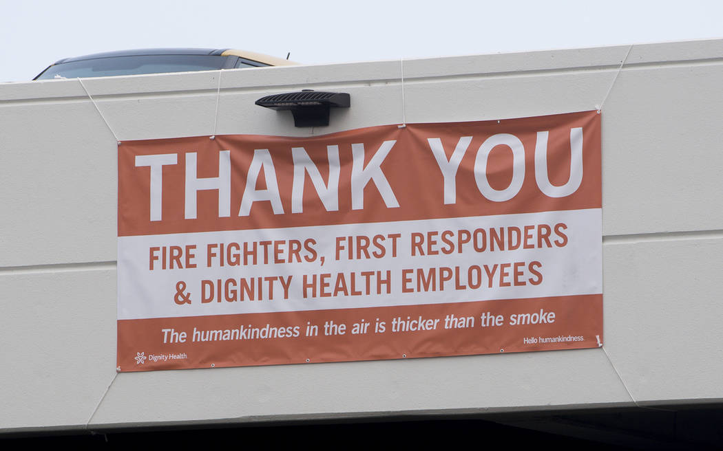 In this photo taken Thursday, Aug. 2, 2018, a thank you banner for fire fighters, first responders and hospital workers hangs outside Mercy Medical Center in Redding, Calif. (AP Photo/Michael Burke)