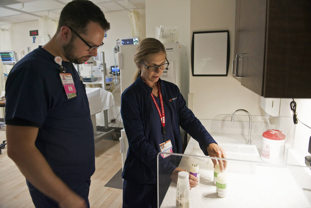 Diane Bell-Gardiner, a registered nurse at Mercy Medical Center, who lost her home in the Carr Fire, orients Christopher Smith, an RN, to the Neonatal Intensive Care Unit in Redding, Calif., Thurs ...