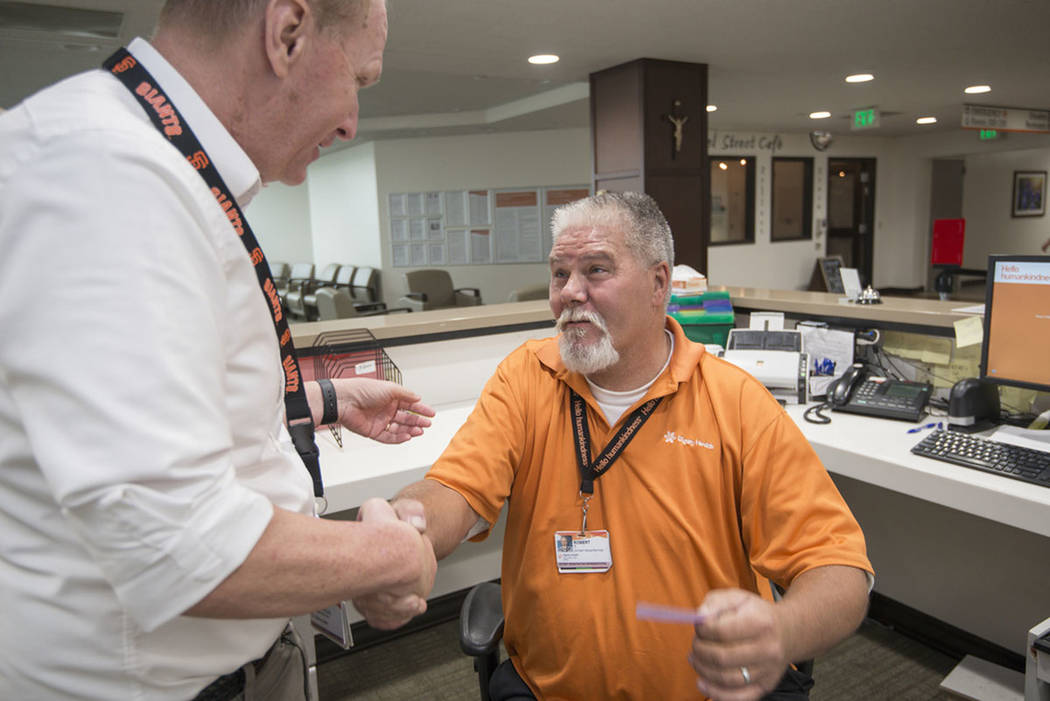 Robert Tierney Jr., right, a patient registration specialist at Mercy Medical Center, who lost his home in the recent fires, receives a message from Dignity Health North State's spokesman Mike Man ...