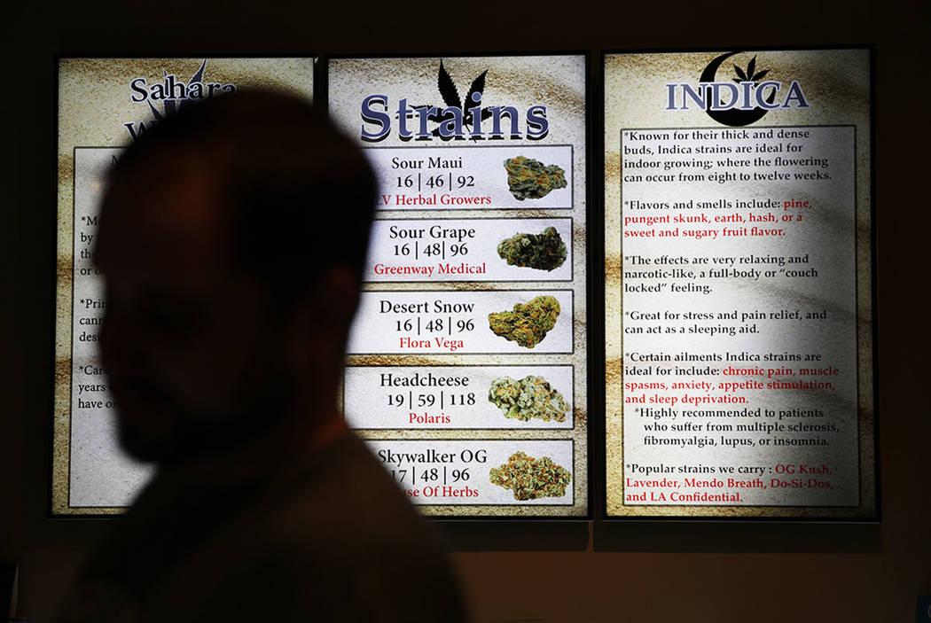 Screens display different strains of marijuana at 420 Sahara Wellness in Las Vegas on July 30, 2018. (AP Photo/John Locher)