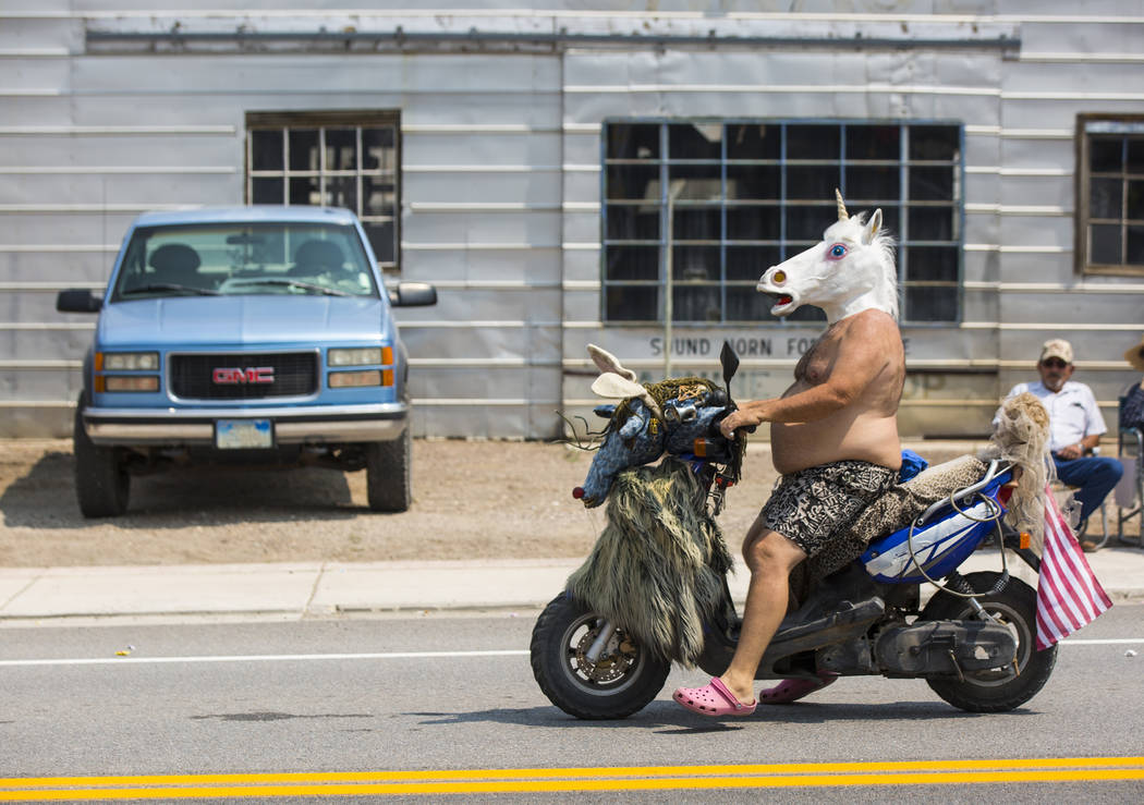 Goldfield resident Fa Can Lee wears a unicorn mask while participating in the parade during the Goldfield Days celebration in Goldfield on Saturday, Aug. 4, 2018. Chase Stevens Las Vegas Review-Jo ...