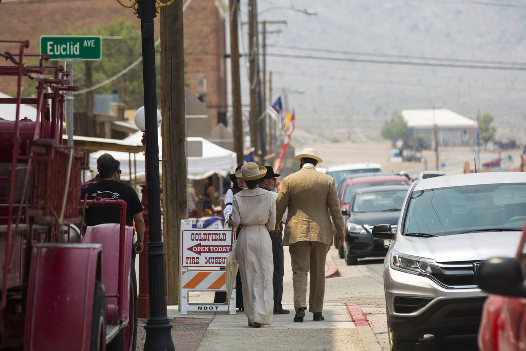 Attendees walk down U.S. Highway 95 during the Goldfield Days celebration in Goldfield on Saturday, Aug. 4, 2018. Chase Stevens Las Vegas Review-Journal @csstevensphoto