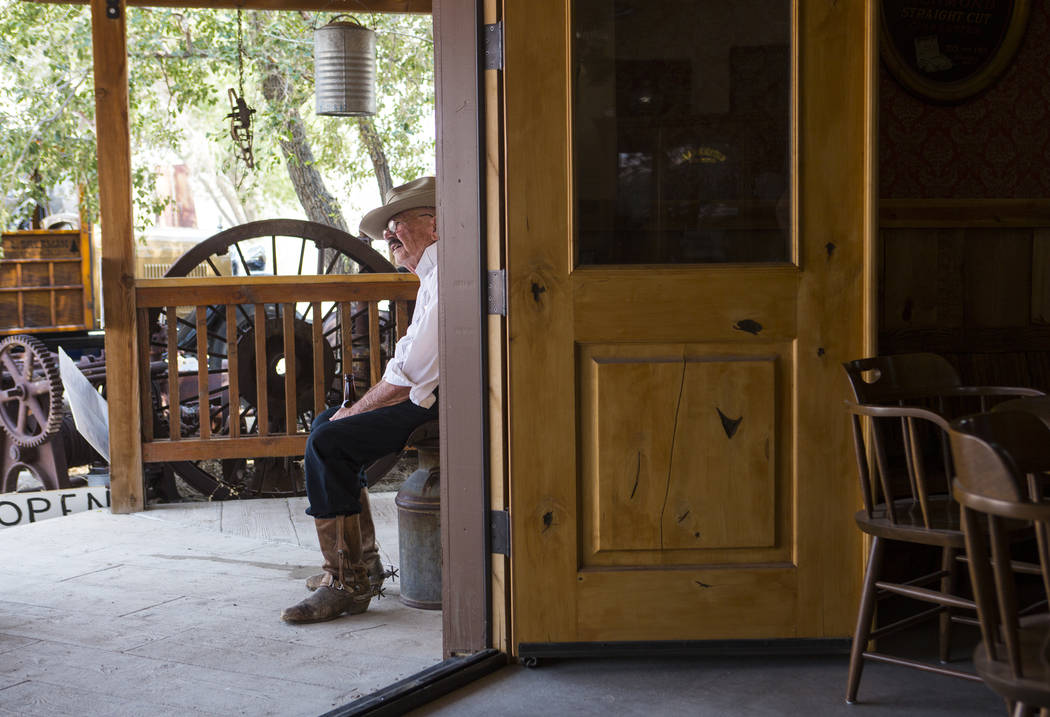 Lee Boblet of Vacaville, Califf., a member of the Blue Canyon Gang, sits outside of The Palace during the Goldfield Days celebration in Goldfield on Saturday, Aug. 4, 2018. Chase Stevens Las Vegas ...