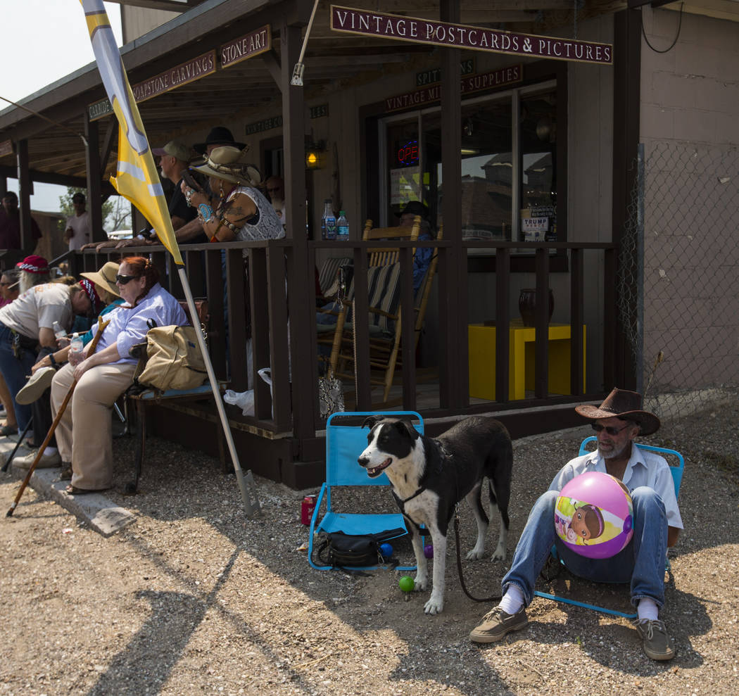 Bruce Dougan of Searchlight watches the parade with dog Skooch during the Goldfield Days celebration in Goldfield on Saturday, Aug. 4, 2018. Chase Stevens Las Vegas Review-Journal @csstevensphoto