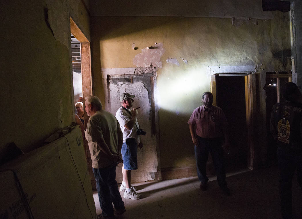 Steve Helt of Las Vegas, center, shines a flashlight while touring the Goldfield Hotel during the Goldfield Days celebration in Goldfield on Saturday, Aug. 4, 2018. Chase Stevens Las Vegas Review- ...