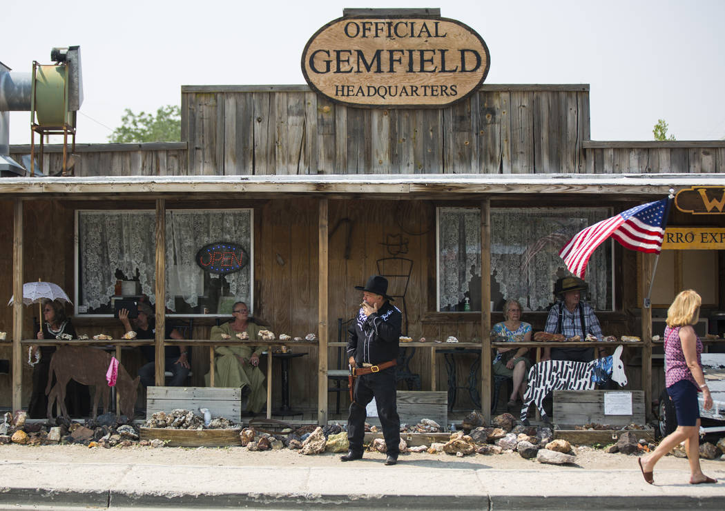 Attendees watch the parade from the Official Gemfield Headquarters during the Goldfield Days celebration in Goldfield on Saturday, Aug. 4, 2018. Chase Stevens Las Vegas Review-Journal @csstevensphoto