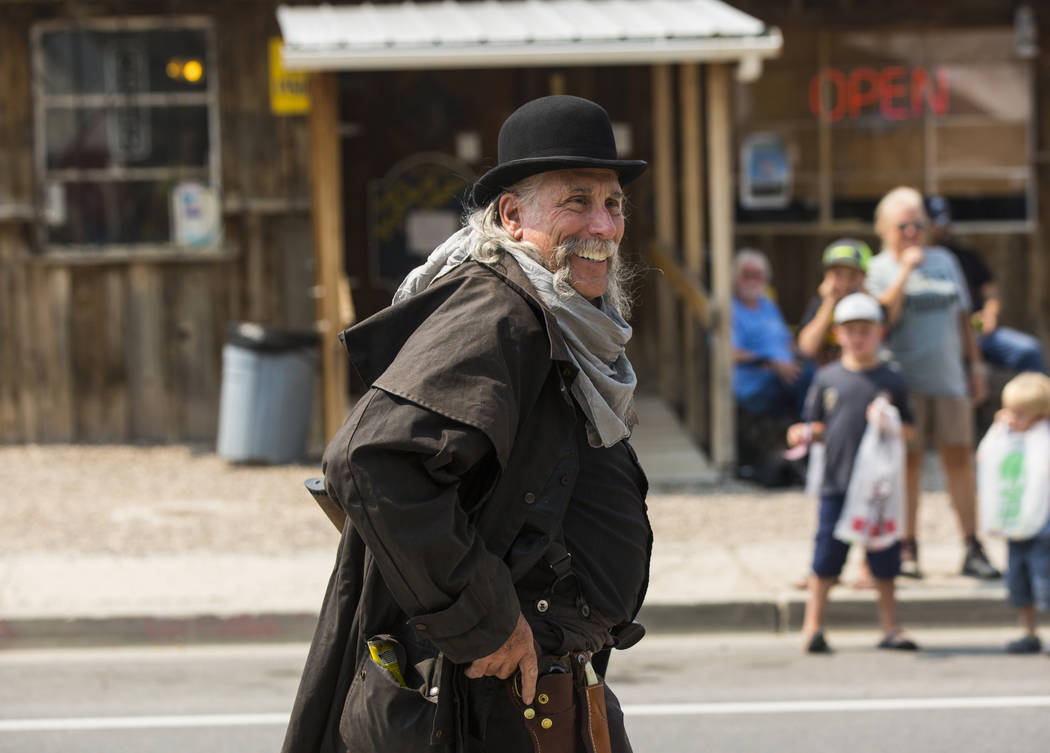 A member of the Blue Canyon Gang takes part in the parade during the Goldfield Days celebration in Goldfield on Saturday, Aug. 4, 2018. Chase Stevens Las Vegas Review-Journal @csstevensphoto
