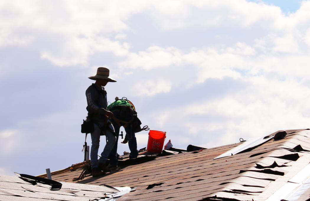 Construction workers labor on rooftops in swelling heat at the Coronado Condominiums in Summerlin. (Madelyn Reese/Las Vegas Review-Journal)