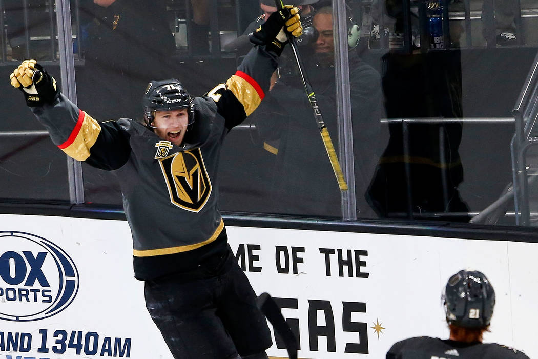 Golden Knights center William Karlsson (71) celebrates his goal against the San Jose Sharks as Golden Knights center Cody Eakin (21) looks on during the third period of an NHL hockey game at T-Mob ...