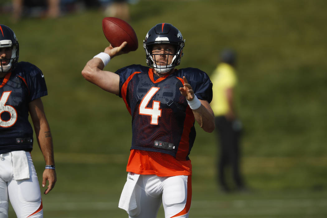 Denver Broncos quarterback Case Keenum (4) takes part in drills during an NFL football training camp Tuesday, Aug. 7, 2018, in Englewood, Colo. (AP Photo/David Zalubowski)