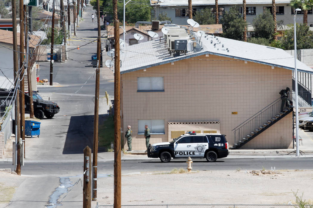 Las Vegas police and a SWAT team are seen around Baltimore Avenue in Las Vegas, Saturday, Aug. 4, 2018. According to Las Vegas police, a man barricaded inside of a downtown Las Vegas home early Sa ...