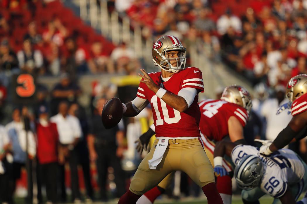 San Francisco 49ers quarterback Jimmy Garoppolo (10) drops back to pass against the Dallas Cowboys during the first half of an NFL preseason football game in Santa Clara, Calif., Thursday, Aug. 9, ...