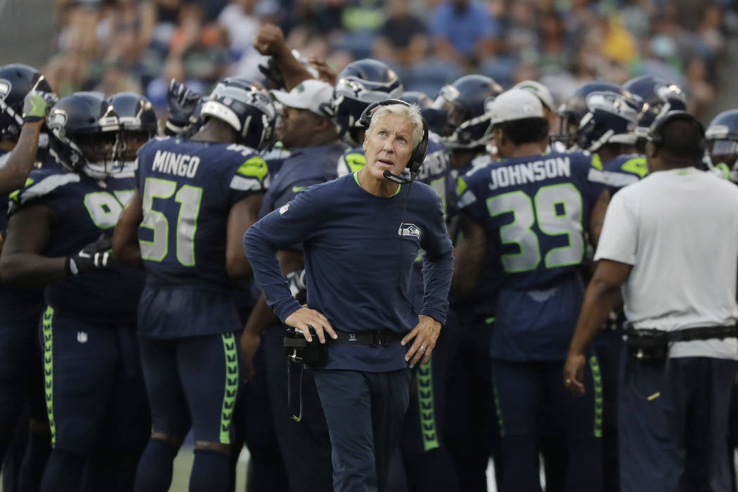 Seattle Seahawks head coach Pete Carroll looks toward the scoreboard during the first half of an NFL football preseason game against the Indianapolis Colts, Thursday, Aug. 9, 2018, in Seattle. (AP ...
