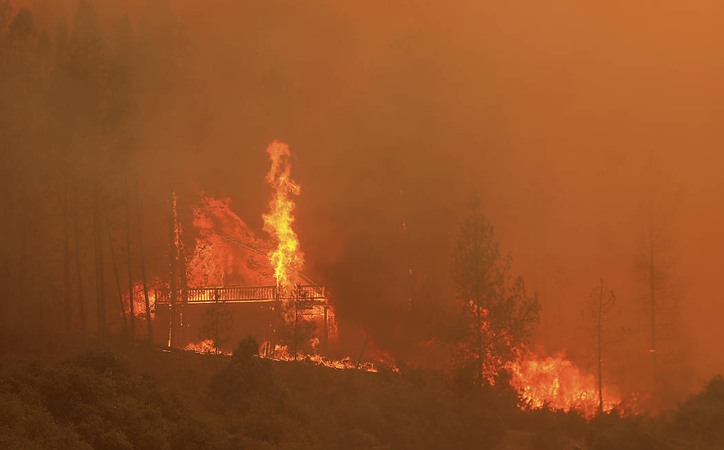 Flames from a wildfire devour a home off Scotts Valley Road, Thursday, Aug. 2, 2018, near Lakeport, Calif. (Kent Porter /The Press Democrat via AP)