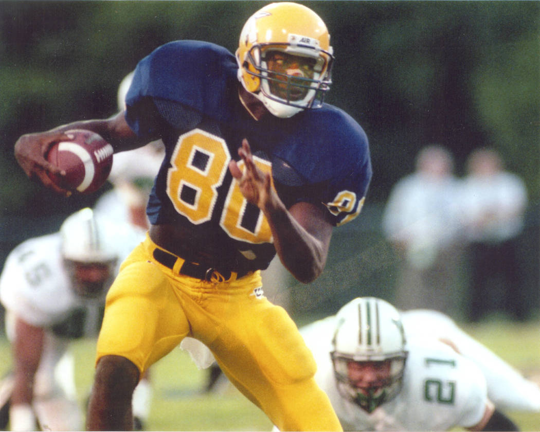 In this undated photo provided by the University of Tennessee Chattanooga athletic department, wide receiver Terrell Owens (80) plays in an NCAA college football game for the school. Owens will be ...