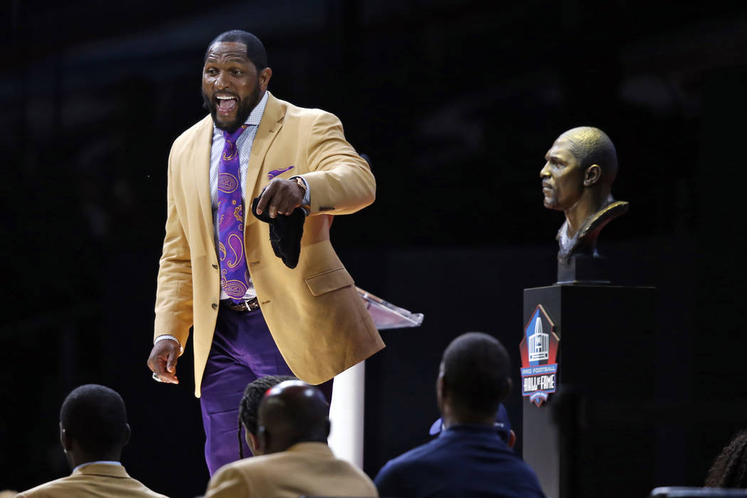 Former NFL player Ray Lewis delivers his speech during an induction ceremony at the Pro Football Hall of Fame Saturday, Aug. 4, 2018, in Canton, Ohio. (AP Photo/Ron Schwane)