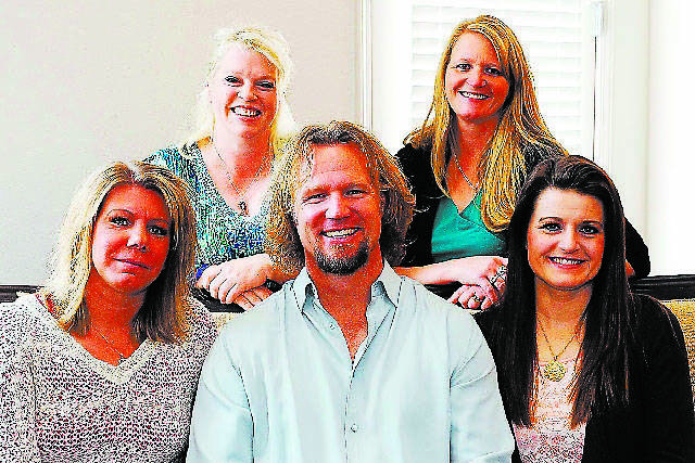 """The polygamist family featured on TLC's """"Sister Wives"""" program is seen in one of its Las Vegas homes. Surrounding Kody Brown are his wives, top row, from left, Janelle and Christine; bottom row, f ..."""