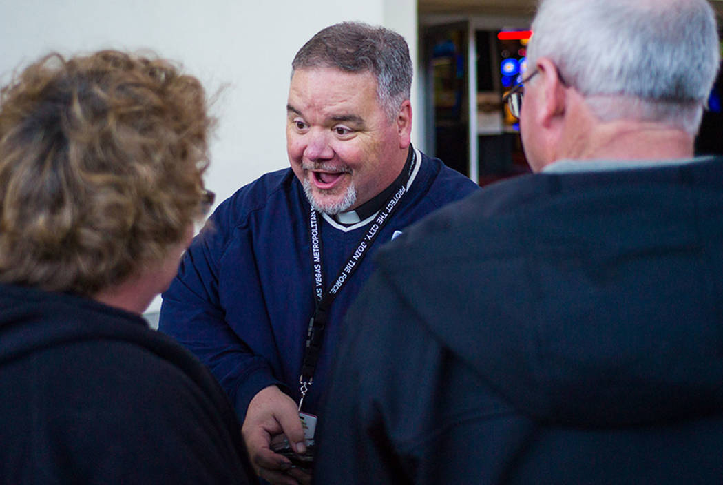 Steve Willis, a senior pastor at First Christian Church, greets tourists along Fremont Street in downtown Las Vegas for Ash Wednesday on Feb. 14, 2018. (Chase Stevens Las Vegas Review-Journal @css ...