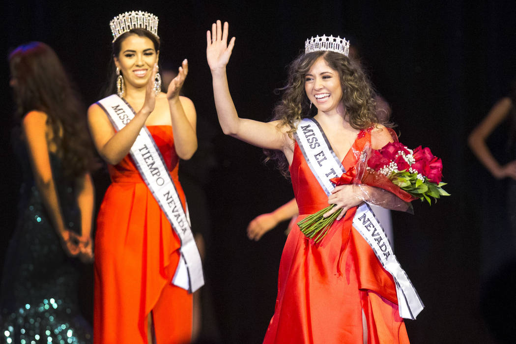 North Las Vegas resident Miranda Contreras, 21, waives to the crowed after being crowned Miss El Tiempo during the Miss El Tiempo pageant at Sam's Town in Las Vegas on Saturday, Aug. 4, 2018. At l ...