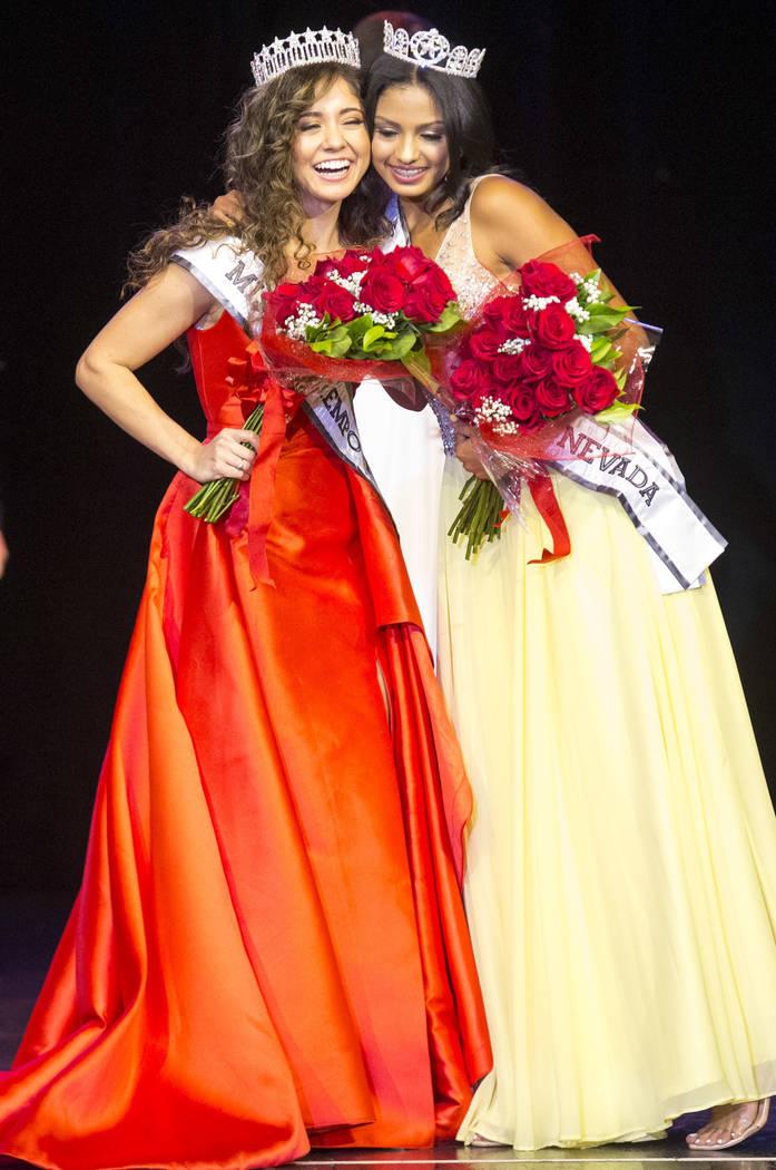 Miss El Tiempo Miranda Contreras, left, and Miss Teen El Tiempo Noelani Mendoza share a hug on stage after being crowned during the Miss El Tiempo pageant at Sam's Town in Las Vegas on Saturday, A ...