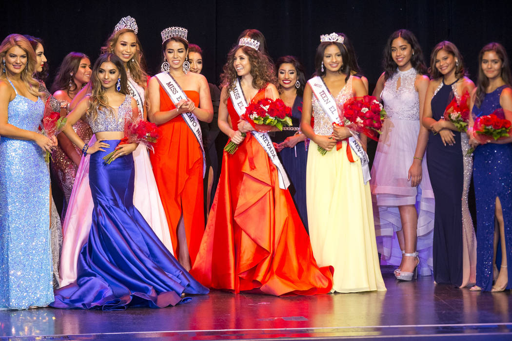 Miss El Tiempo Miranda Contreras, center, and Miss Teen El Tiempo Noelani Mendoza, fourth right, pose with fellow contestants after being crowned during the Miss El Tiempo pageant at Sam's Town in ...