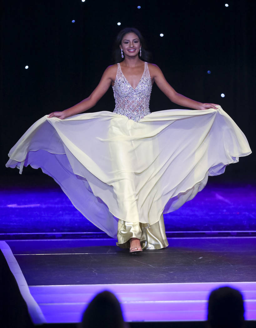 North Las Vegas resident Noelani Mendoza, 14, participates in the evening gown competition during the Miss El Tiempo pageant at Sam's Town in Las Vegas on Saturday, Aug. 4, 2018. Richard Brian Las ...