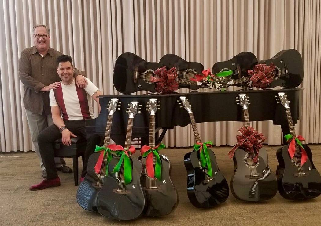 Nevada School of the Arts President and CEO Patrick Duffy, left, and Frankie Moreno are shown with 10 Gibson guitars donated by Moreno on Tuesday, July 31, 2018. (Nevada School of the Arts)