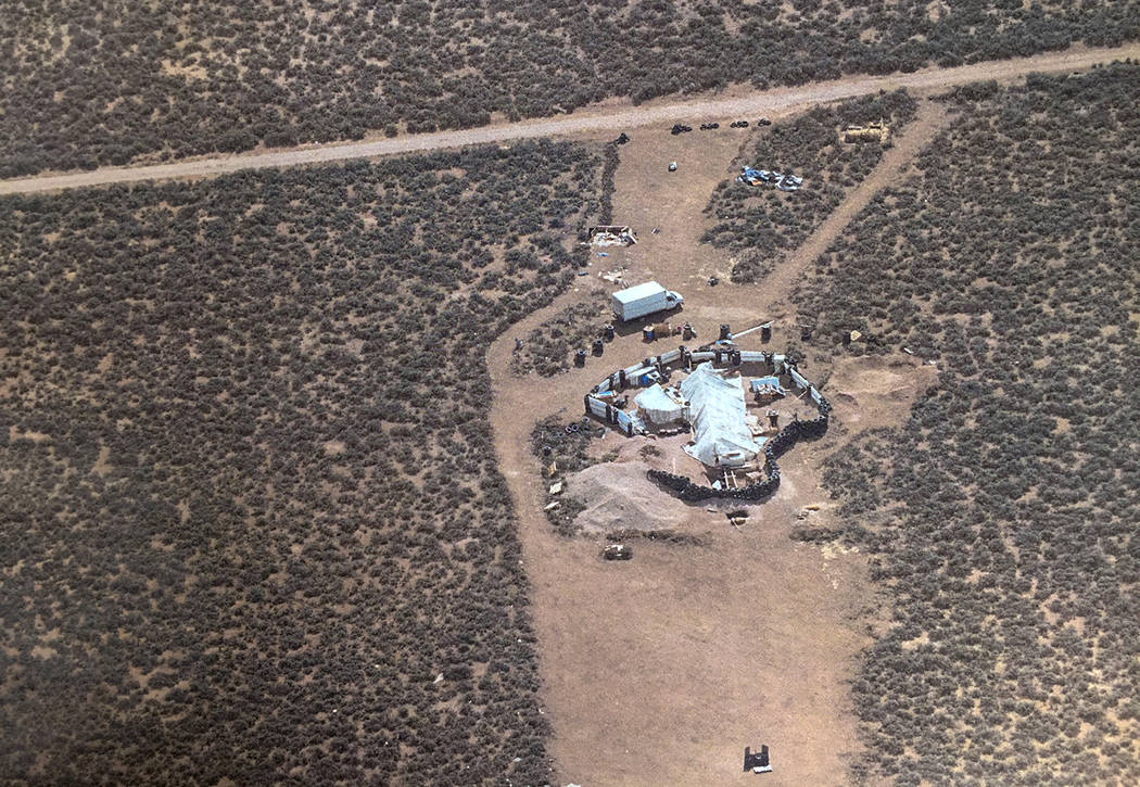 An aerial photo shows a rural compound on Friday, Aug. 3, 2018, during an unsuccessful search for a missing 3-year-old boy in Amalia, New Mexico. Law enforcement officers searching the compound fo ...