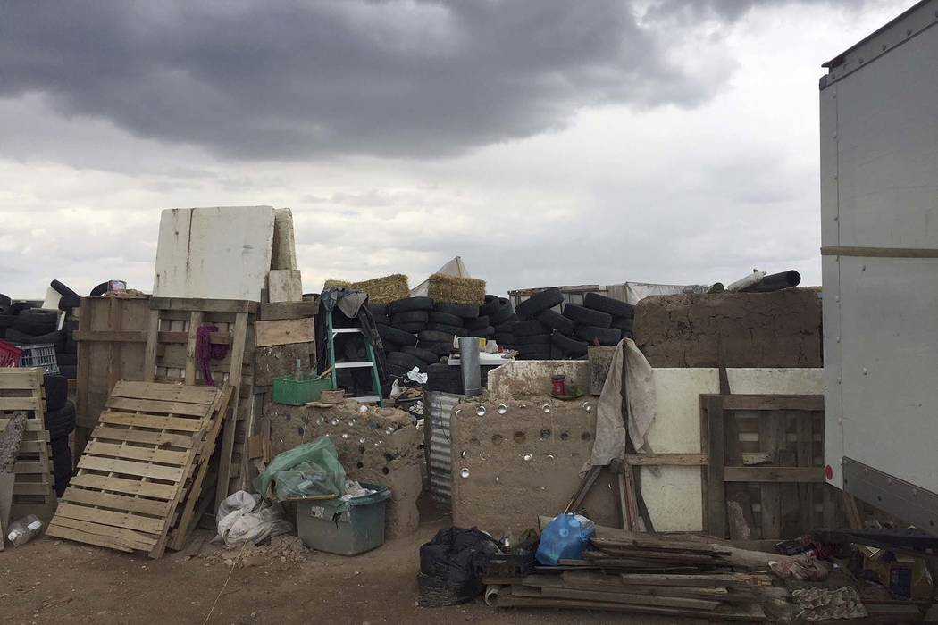Law enforcement officers searching a rural compound near Amalia, New Mexico, for a missing 3-year-old boy didn't locate him but found 11 other children in filthy conditions and hardly any food, a ...