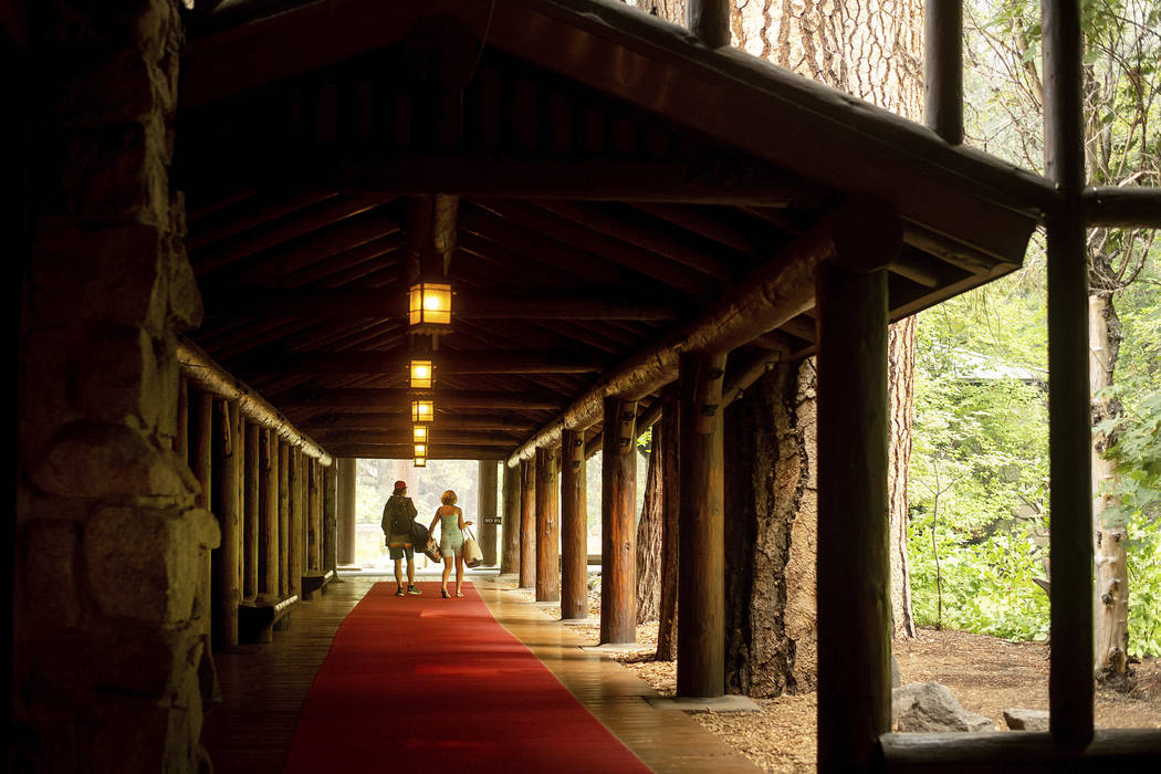 Guests leave the The Majestic Yosemite Hotel‎, formerly The Ahwahnee Hotel, shortly after it closed in Yosemite National Park, Calif., July 25, 2018. Yosemite National Park could reopen its scen ...