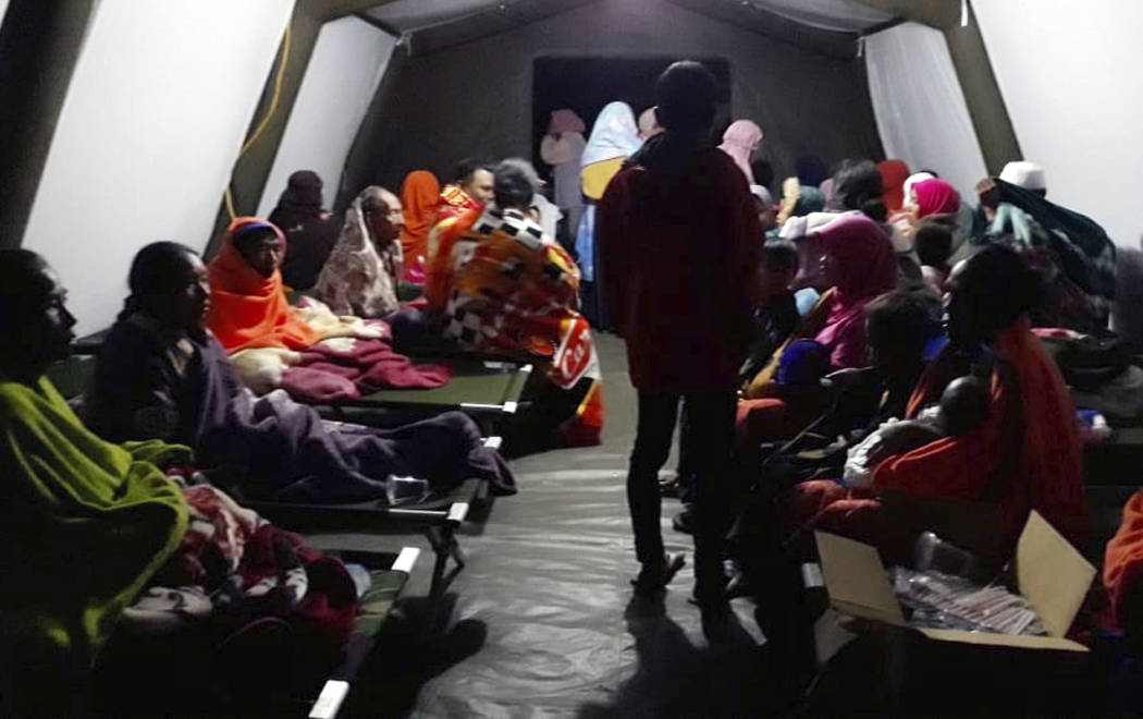 People affected by the earthquake rest at a temporary shelter in Lombok, Indonesia, Sunday, Aug. 5, 2018. A strong earthquake struck Indonesia's popular tourist island of Lombok on Sunday, trigger ...