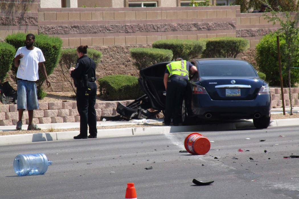 North Las Vegas police investigate a two-car crash at Tropical Parkway and Palmilla Street that left one person in&# ...