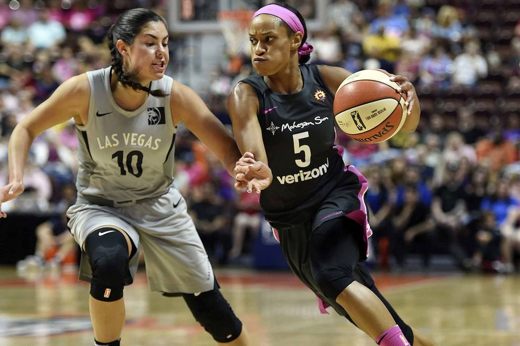 Connecticut Sun guard Jasmine Thomas (5) drives past Las Vegas Aces guard Kelsey Plum (10) in the first half half of WNBA basketball game action Sunday, Aug. 5, 2018, in Uncasville, Conn. (Sean D. ...