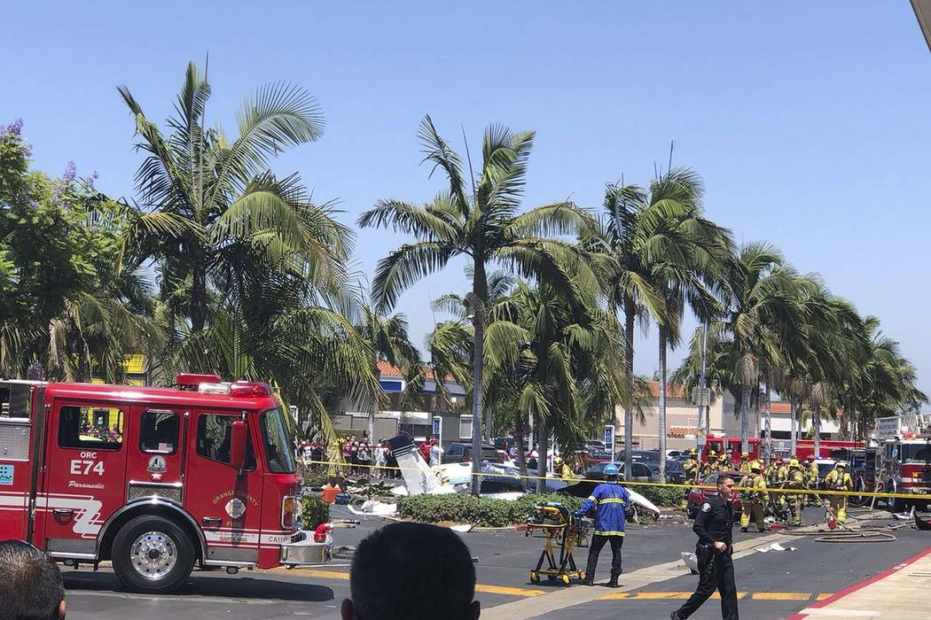A twin-engine aircraft crashed near the South Coast Plaza shopping center in Santa Ana, Calif., Sunday, Aug. 5, 2018. Federal Aviation Administration spokeswoman Arlene Salac says the twin-engine ...
