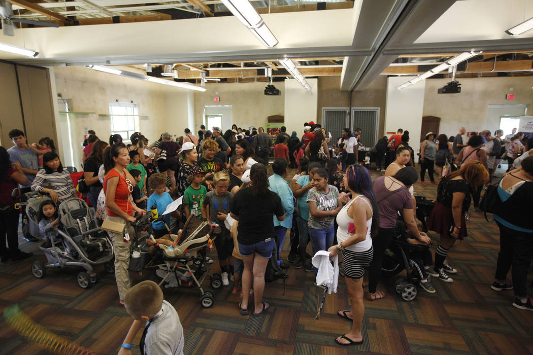 Families wait in line at the annual Back to School Fair organized by the Happy Face Foundation at Springs Preserve in Las Vegas, Sunday, Aug. 5, 2018. Students received free school supplies as wel ...