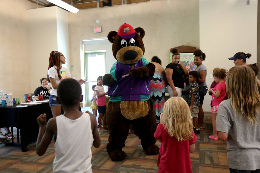 Incredibear from John's Incredible Pizza Company dances with kids at the annual Back to School Fair organized by the Happy Face Foundation at Springs Preserve in Las Vegas, Sunday, Aug. 5, 2018. S ...