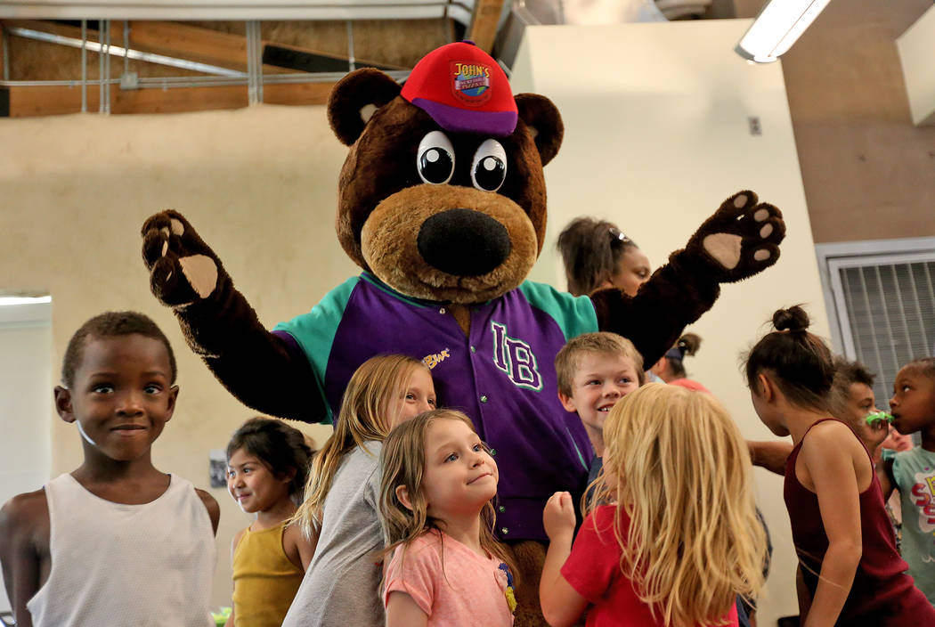 Incredibear from John's Incredible Pizza Company greets kids at the annual Back to School Fair organized by the Happy Face Foundation at Springs Preserve in Las Vegas, Sunday, Aug. 5, 2018. Studen ...