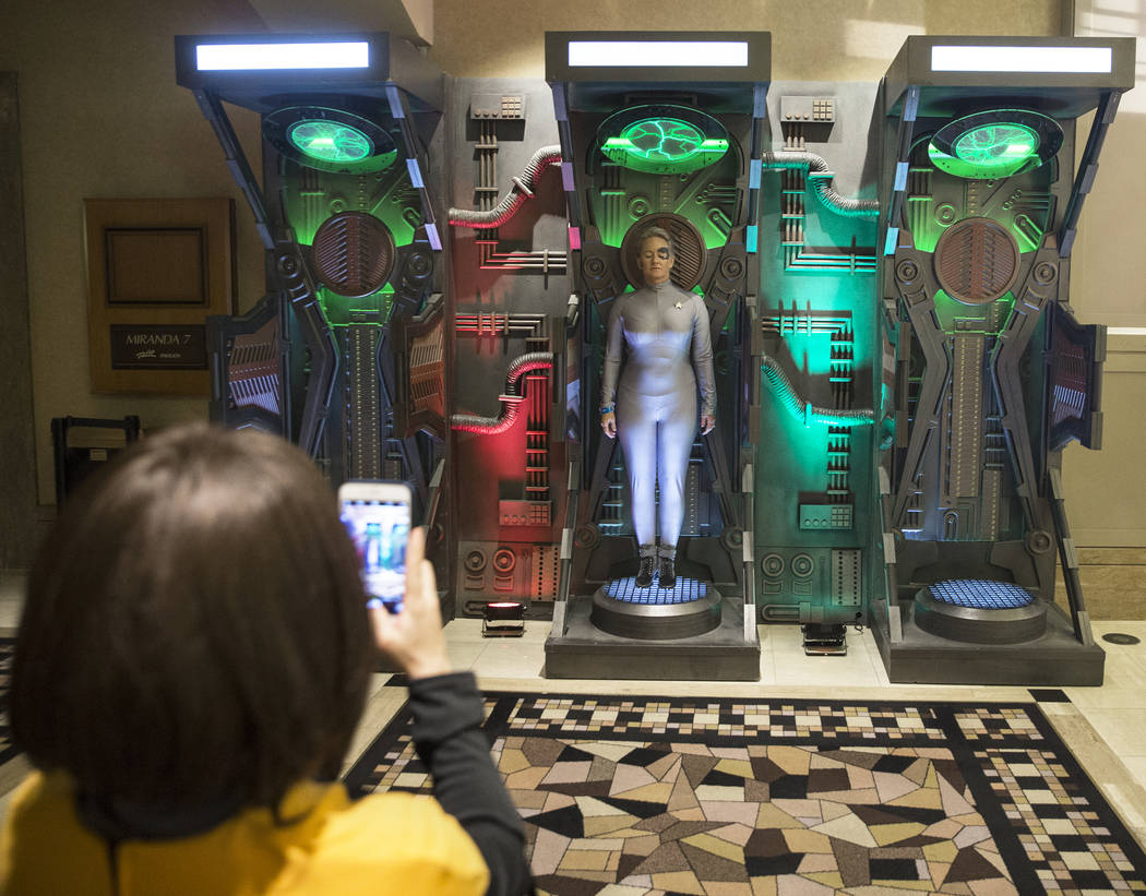 "Las Vegas resident Diane Wallace, dressed as ""7 of 9,"" gets her photo taken in a replica of a Star Trek transporter on Thursday, Aug. 2, 2018, at the Star Trek Las Vegas convention, at t ..."