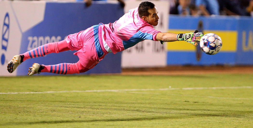Las Vegas Lights FC goalkeeper Ricardo Ferrino (1) blocks a shot in the first half of a soccer game against Rio Grande Valley FC at Cashman Field in Las Vegas on Saturday, Aug. 4, 2 ...