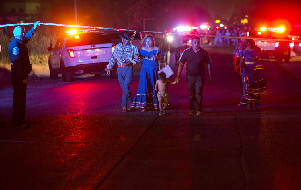 People leave the scene of a shooting that broke outside a party near Allen and Coran lanes in North Las Vegas on Saturday, Aug. 4, 2018. Richard Brian Las Vegas Review-Journal @vegasphotograph
