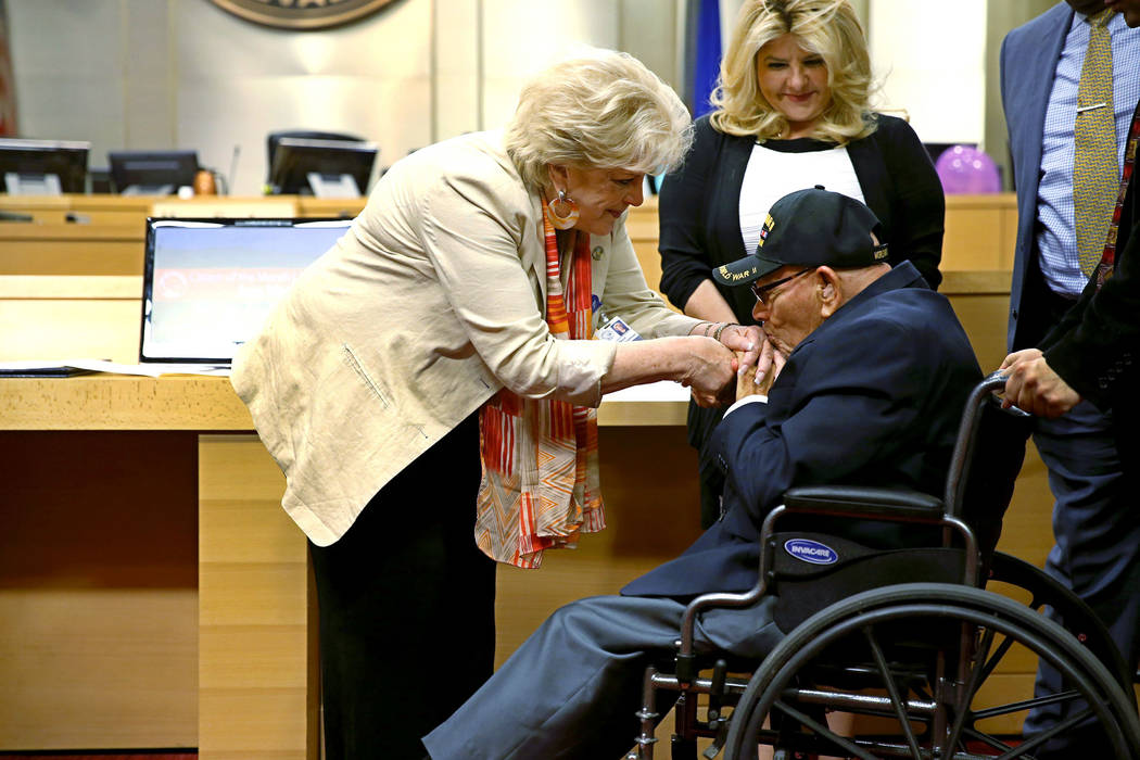 DO NOT USE -- HOLD FOR FUTURE STORY -- Las Vegas Mayor Carolyn Goodman, left, with Joe Vento, 100, as he is recognized as citizen of the month, during a city council meeting at Las Vegas City Hall ...