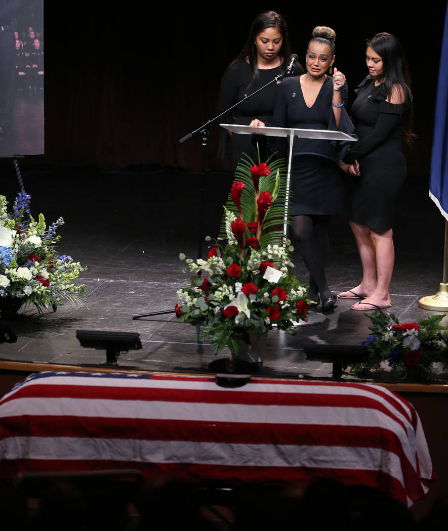 Daughters of Las Vegas Corrections Officer Kyle Eng, from left, Kayla Eng, Alexa Untalasco and Alyssa Eng, during funeral services for their father at Canyon Ridge Christian Church Monday, July 20 ...