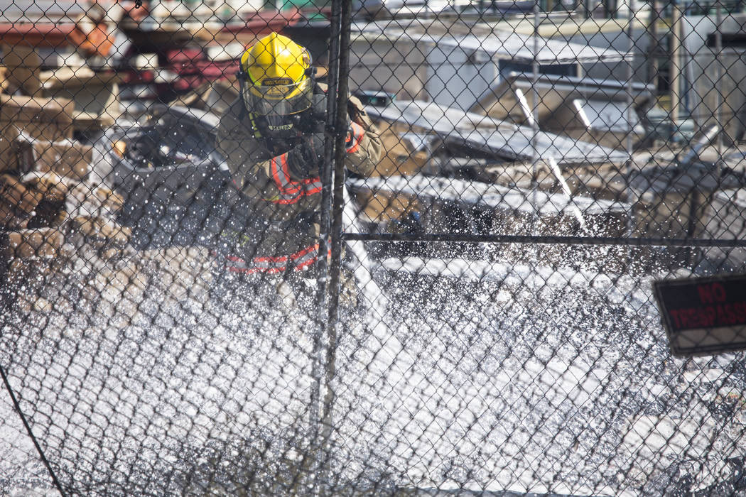 Firefighters work to extinguish a fire at a storage yard on the 3100 block of Highland Drive below the Desert Inn overpass in Las Vegas on Sunday, Aug. 5, 2018. Richard Brian Las Vegas Review-Jour ...