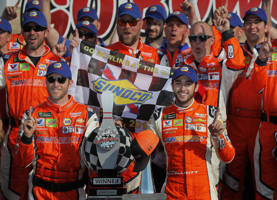 Chase Elliott, front right, poses for a photo with his pit crew after winning a NASCAR Cup series auto race, Sunday, Aug. 5, 2018, in Watkins Glen, N.Y. (AP Photo/Julie Jacobson)
