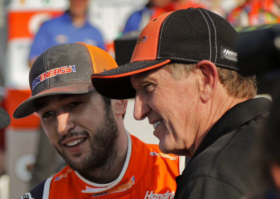 Chase Elliott, left, and his father Bill Elliott answer questions during an interview after Chase won a NASCAR Cup Series auto race, Sunday, Aug. 5, 2018, in Watkins Glen, N.Y. (AP Photo/Julie Jac ...