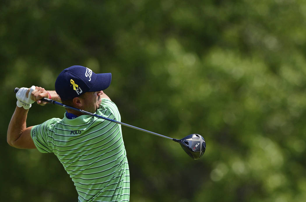Justin Thomas watches his tee shot on the sixth hole during the final round of the Bridgestone Invitational golf tournament at Firestone Country Club, Sunday, Aug. 5, 2018, in Akron, Ohio. (AP Pho ...