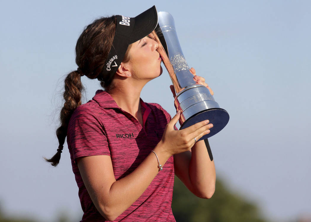 England's Georgia Hall kisses the trophy after winning the Women's British Open at Royal Lytham & St Annes Golf Club, in Lytham, England, Sunday Aug. 5, 2018. (Richard Sellers/PA via AP)
