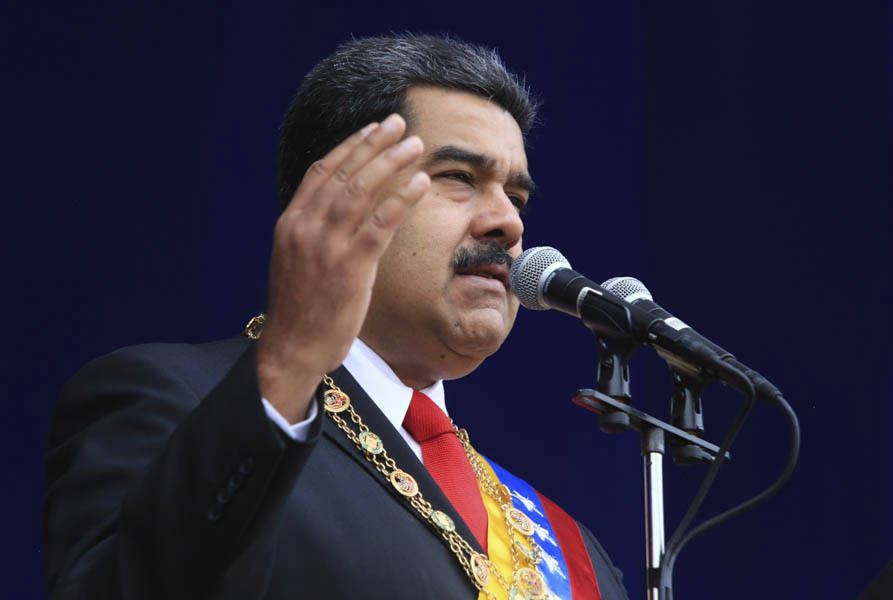 In this photo provided by the Miraflores Presidential Palace, President Nicolas Maduro speaks during a event marking the 81st anniversary of the National Guard, in Caracas, Venezuela, Saturday, Au ...