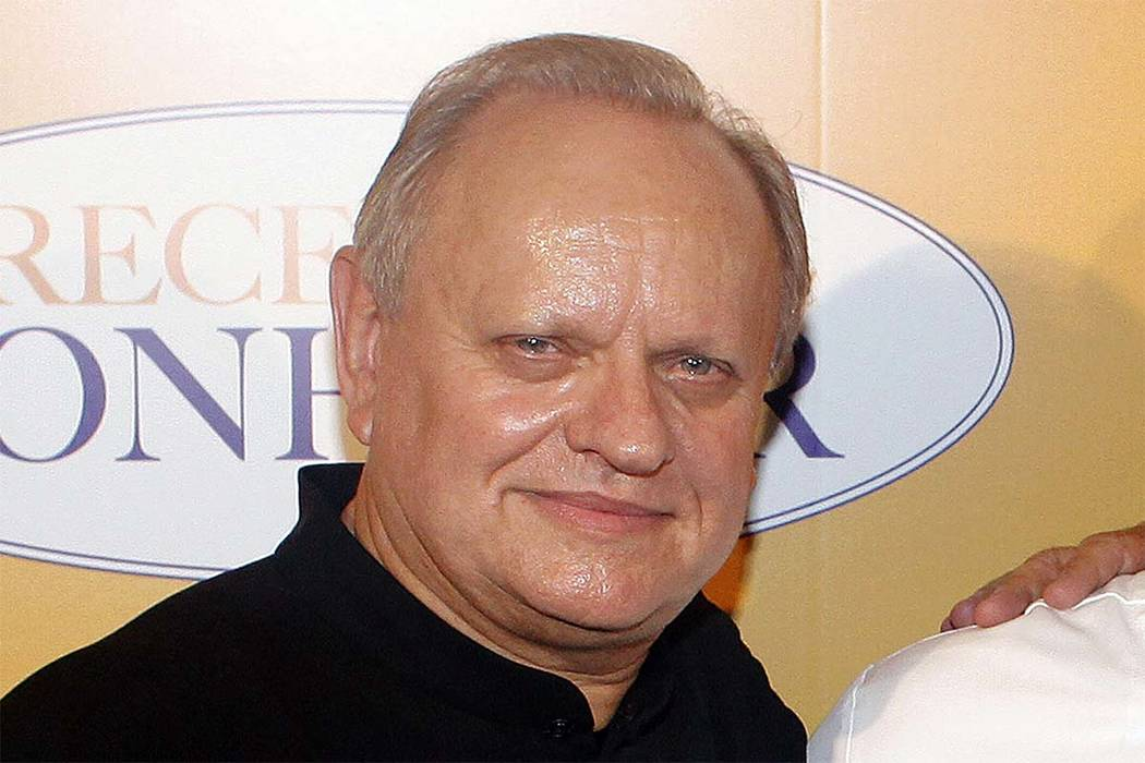 "In this Sept.7, 2014 file photo, French chef Joel Robuchon poses for photographers during a photocall for the movie ""The Hundred-Foot Journey"" in Paris. (Thibault Camus/AP file)"