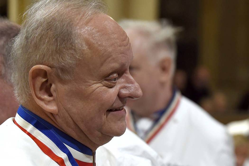 In this Jan.26, 2018 file photo, French chef Joel Robuchon attends the funeral for late French chef Paul Bocuse at the Saint-Jean cathedral, in Lyon, central France. French master chef Joel Robuch ...